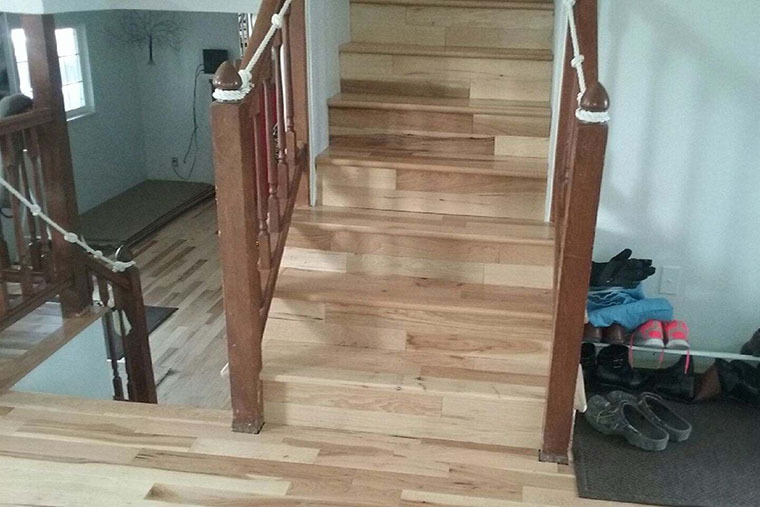 Hardwood floor installed on stairs